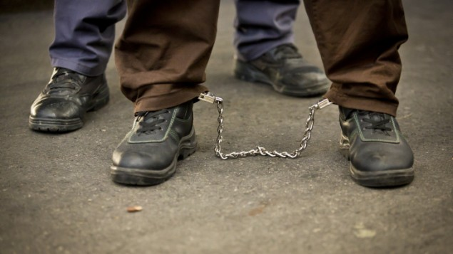 A Palestinian prisoner in leg cuffs in Israel (photo credit: Moshe Shai/Flash90)