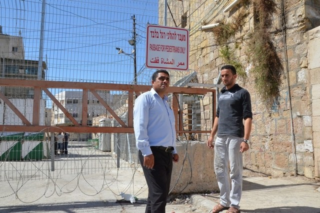Hazem Abu Rajab, 28, whose family is being forced out of their home in Hebron by the Israeli army and settlers, with Badee Dwaik, leader of a non-government organisation Human Rights Defenders. Kate Shuttleworth for The National / August 15, 2015
