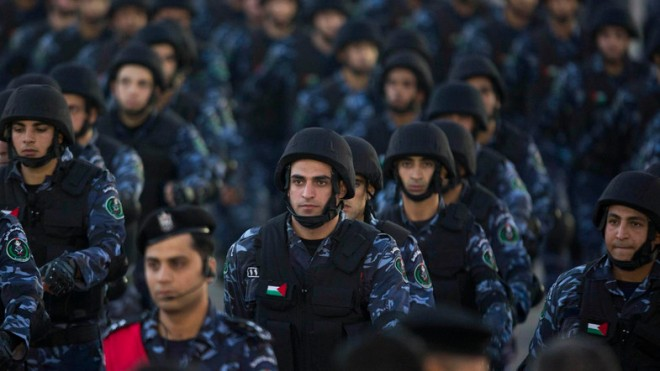Palestinian security forces march, as they mark the 50th anniversary of the Fatah movement in the West Bank city of Ramallah, Wednesday, Dec. 31, 2014. (AP Photo/Majdi Mohammed)