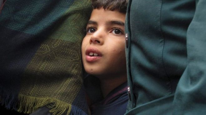 A Syrian boy, 7, waits to board a train in Budapest, Hungary, Thursday, Sept. 10, 2015.AP