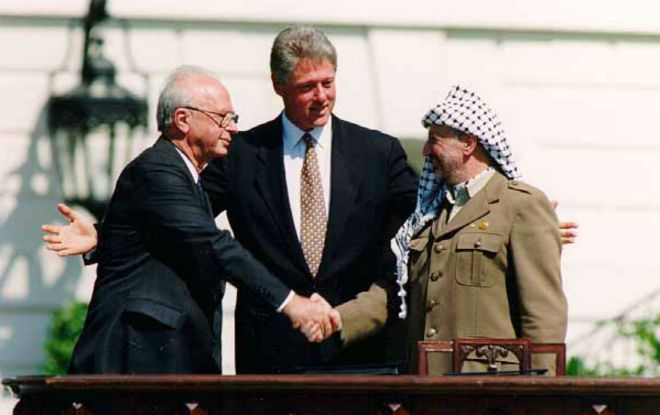 Yitzhak Rabin, Bill Clinton, and Yasser Arafat shaking hands at the Oslo Accords signing ceremony. (White House)