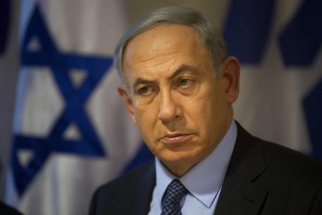 "Israeli Prime Minister Benjamin Netanyahu looks on during a press conference at the Foreign Ministry in Jerusalem, Thursday, Oct. 15, 2015. Netanyahu on Thursday said he would be ""perfectly open"" to meeting with Palestinian President Mahmoud Abbas in order to end weeks of Israeli-Palestinian unrest. (ANSA/AP Photo/Sebastian Scheiner)"