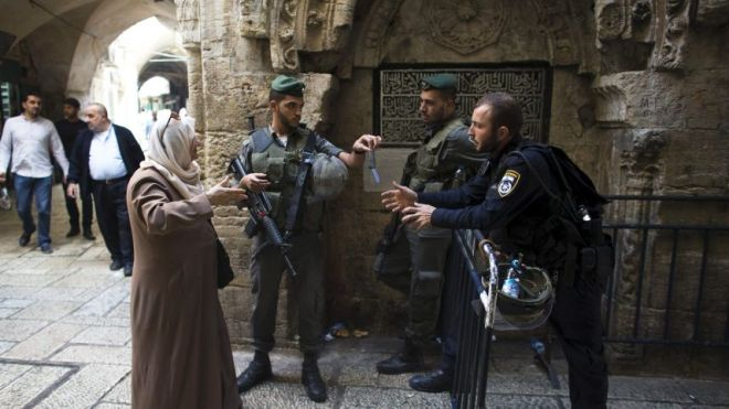 Border police check Palestinian's credit:AP