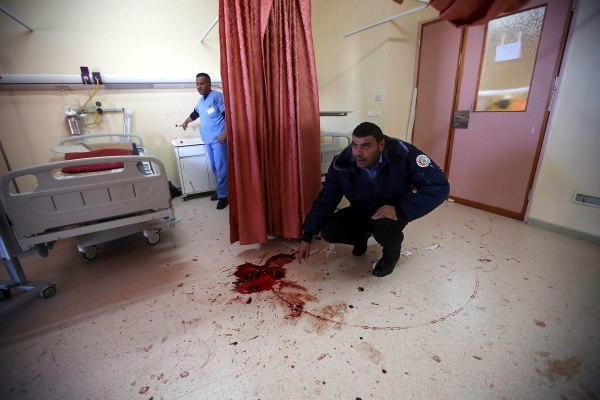 epa05021437 Palestinian hospital security checks the room where Israeli special forces killed 27 years old Abdallah Shalaldeh and arrested his cousin at the Al-Ahli hospital in the West Bank city of Hebron 12 November 2015. Shalaldeh was shot dead by Israeli special forces during a raid to arrest his cousin Azzam Shalaldeh. An undercover Israeli unit raided a southern West Bank hospital early 12 November, killing one Palestinian and seizing another, the Palestinian Health Ministry said. An Israeli military spokeswoman in Tel Aviv said that security forces had sought to apprehend a Palestinian accused of stabbing an Israeli outside a settlement bloc south of Jerusalem on 25 October 2015. The alleged Palestinian assailant, Azzam Shalaldeh, 20, had been shot by the Israeli victim. The Israeli was, in turn, severely injured with a stab wound to the chest. EPA/ABED AL HASHLAMOUN ATTENTION EDITORS PICTURE CONTAINS GRAPHIC CONTENT