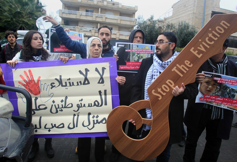 Palestinians of the familySub Laban, take part in a protest in front of the EU headquarters to demand their protection from the Jewish settlers who are trying to takeover their house in the Old City of Jerusalem